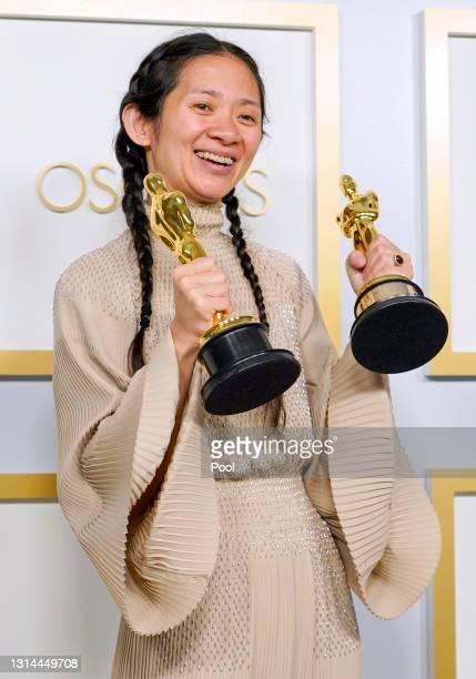 """Director/Producer Chloe Zhao, winner of Best Directing and Best Picture for """"Nomadland,"""" poses in the press room at the Oscars on Sunday, April 25 at..."""