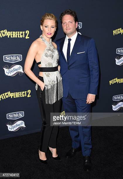 Director/producer Elizabeth Banks and producer Max Handelman arrive at the World Premiere of Pitch Perfect 2 held at the Nokia Theatre LA Live on...