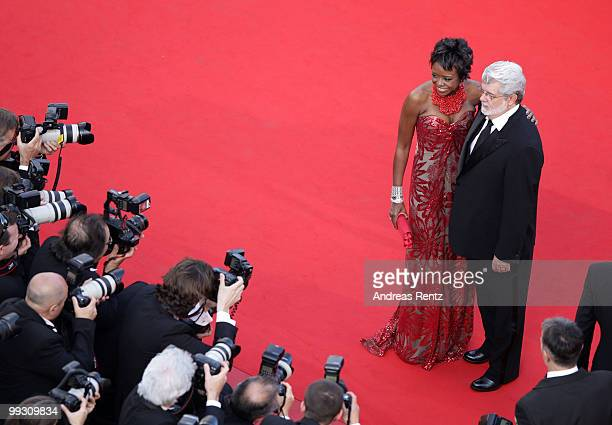 """Director/producer George Lucas and wife Mellody Hobson attend the """"Wall Street: Money Never Sleeps"""" Premiere at the Palais des Festivals during the..."""