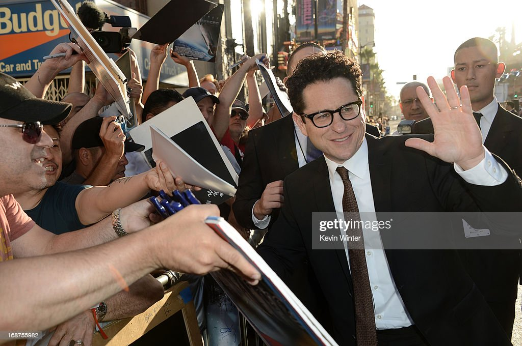 Director/Producer J.J. Abrams poses with fans as he arrives at the Premiere of Paramount Pictures' 'Star Trek Into Darkness' at Dolby Theatre on May 14, 2013 in Hollywood, California.