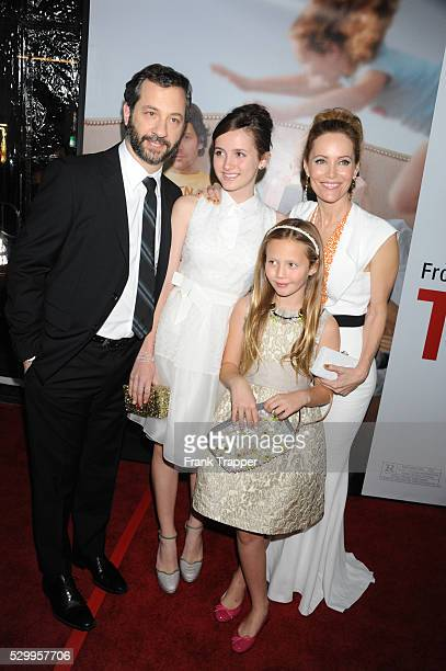 Director/producer Judd Apatow and wife actress Leslie Mann arrive with his daughters Maude and Iris at the premiere of This Is 40 held at Grauman's...