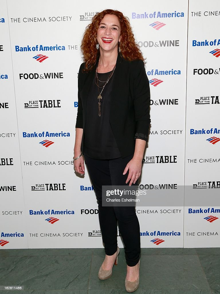 Director/producer Kristi Jacobson arrives at Bank of America and Food & Wine with The Cinema Society present a screening of 'A Place at the Table' at the Celeste Bartos Theater at the Museum of Modern Art on February 27, 2013 in New York City.