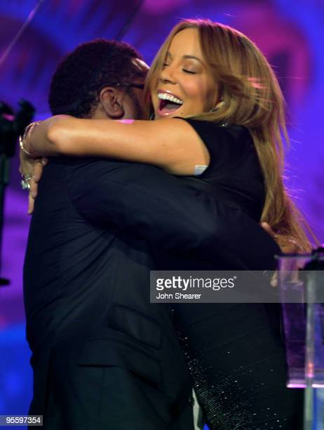Director/producer Lee Daniels presents actress/singer Mariah Carey with the Breakthrough Actress Performance award onstage at the 2010 Palm Springs...