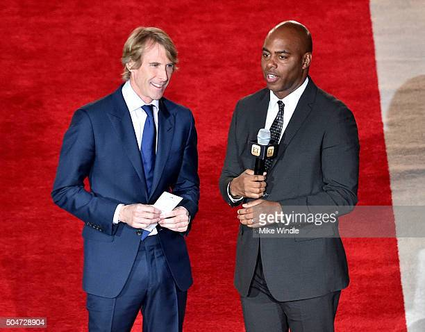 Director/producer Michael Bay and TV personality Kevin Frazier attend the Dallas Premiere of the Paramount Pictures film '13 Hours The Secret...