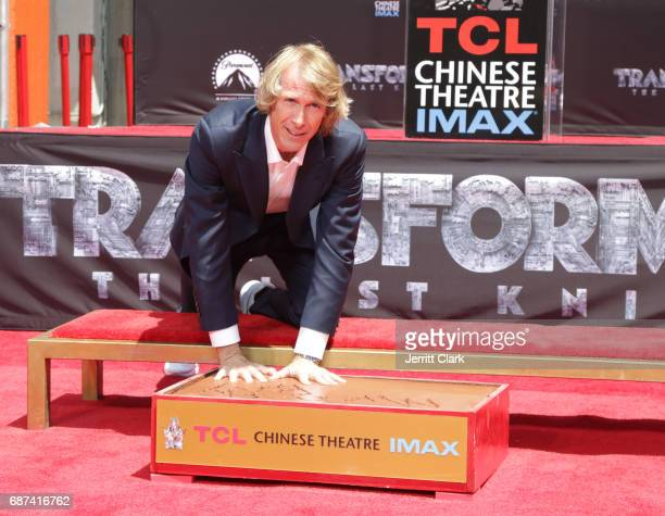 Director/Producer Michael Bay places his hands in cement during his Hand And Footprint Ceremony at TCL Chinese Theatre IMAX on May 23 2017 in...