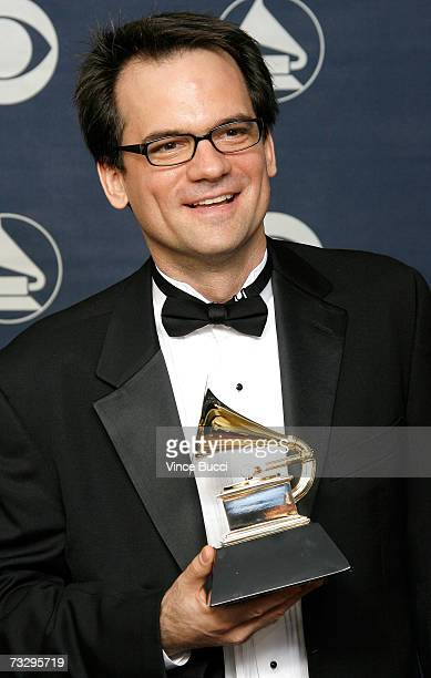 Director/producer Thom Zimmy poses with his Grammy for Best Long Form Music Video in the press room at the 49th Annual Grammy Awards at the Staples...