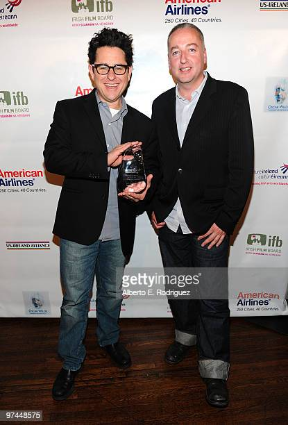 Director/producer/writer JJ Abrams poses with the Oscar Wilde honorary Irishman award with cinematographer Seamus McGarvey during the 5th Annual...
