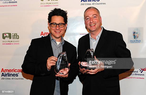 Director/producer/writer JJ Abrams poses with the Oscar Wilde honorary Irishman award and cinematographer Seamus McGarvey poses with the Oscar Wilde...