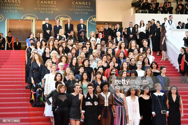 Directors, actresses and industry representatives pose on the red carpet in protest of the lack of female filmmakers honored throughout the history...