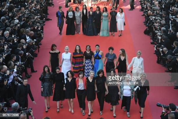 Directors, actresses and industry representatives walk the red carpet in protest of the lack of female filmmakers honored throughout the history of...