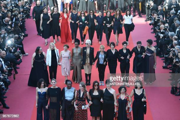 Directors, actresses, producers and industry representatives walk the red carpet in protest of the lack of female filmmakers honored throughout the...