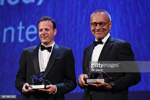 Directors Andrei Konchalovsky and Amat Escalante pose with the Silver Lions for Best Director for 'Paradise' and for 'The Untamed' during the closing...