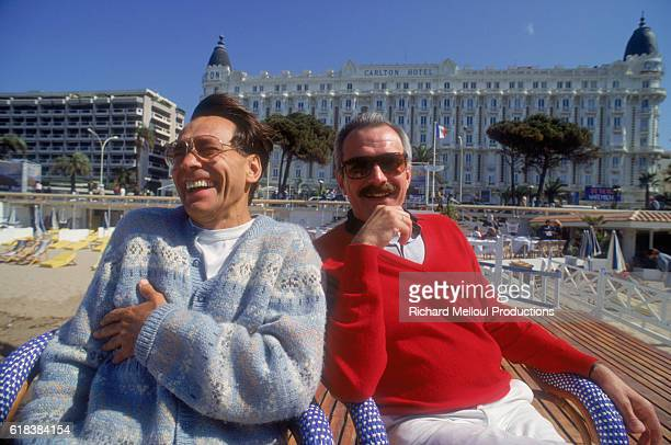 Directors Andrei Konchalovsky and Nikita Mikhalkov share a laugh in Cannes, France. The two brothers are attending the 1987 Cannes Film Festival.