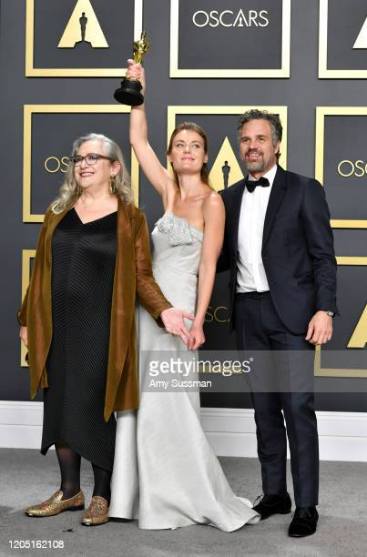 """Directors Carol Dysinger and Elena Andreicheva winners of the Documentary Feature award for """"Learning to Skateboard in a Warzone """" pose with Mark..."""