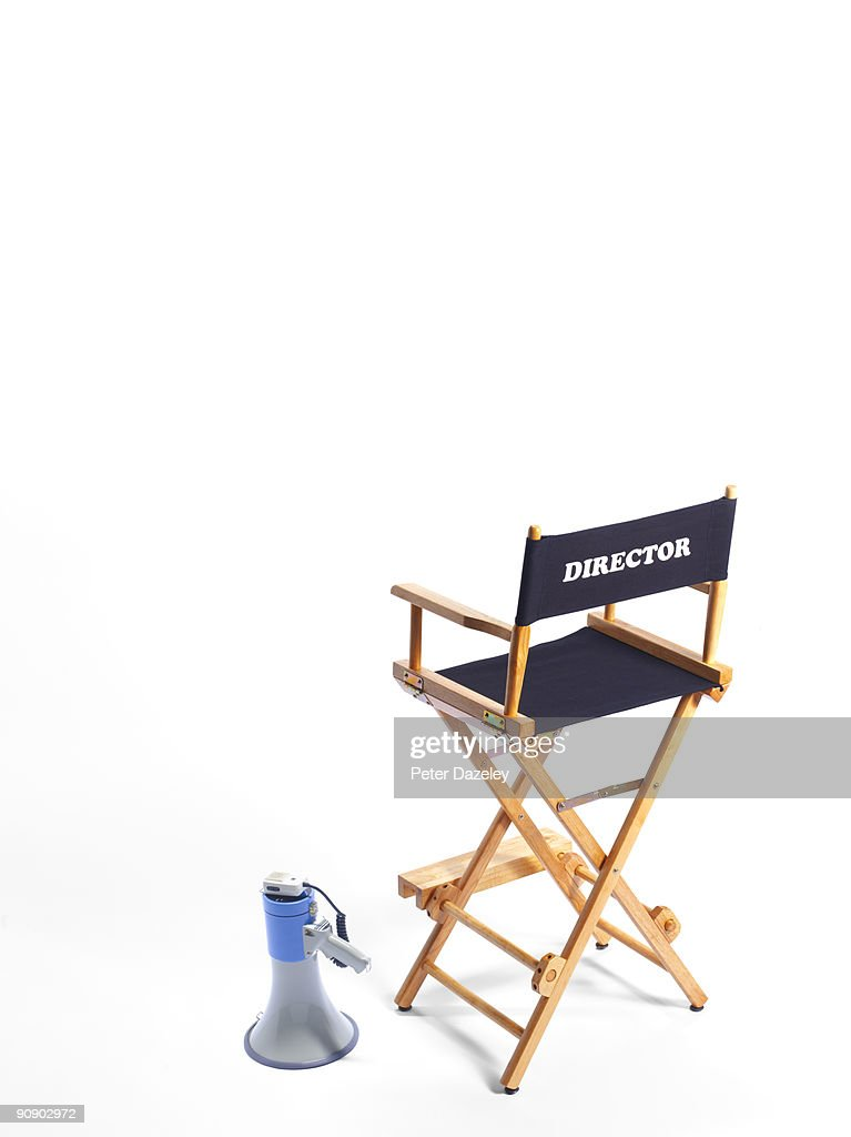 Directors chair and megaphone on white background. : Stock Photo