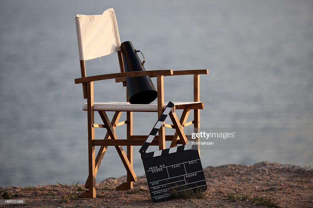 Director's chair in outdoor with megaphone and film slate. : Stock Photo