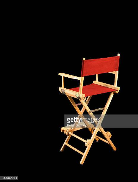 directors chair on black background. - director's chair stock pictures, royalty-free photos & images