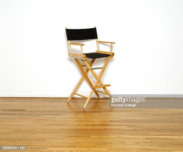 Director's chair on wooden floor, close-up