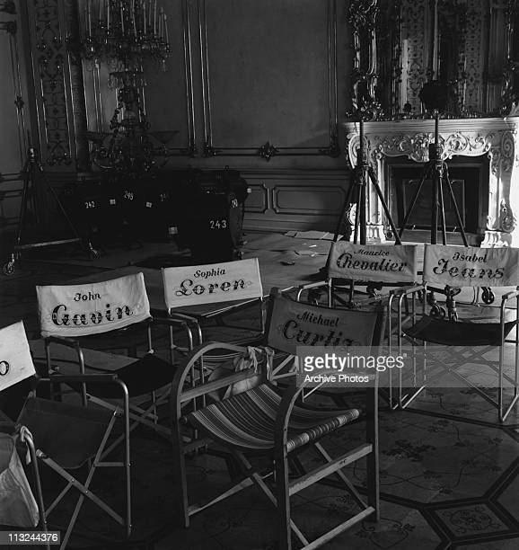 Director's chairs with the names of stars John Gavin Sophia Loren Maurice Chevalier and Isabel Jeans on the set of the Michael Curtiz film 'A Breath...