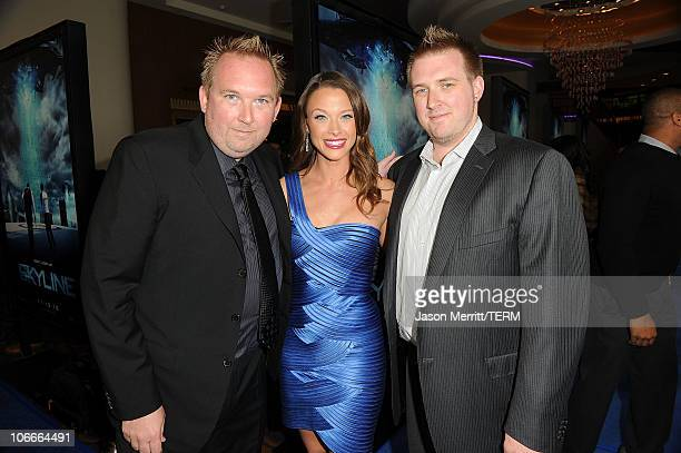 Directors Colin Strause and Greg Strause pose with actress Scottie Thompson at the premiere of Rogue Pictures' Skyline on November 9 2010 in Los...