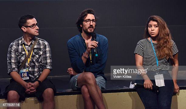 Directors Dima Otvertchenko and Ilker Catak and programming assistant at the Palm Springs International ShortFest Kelanie Aragon Silva do a QA at the...