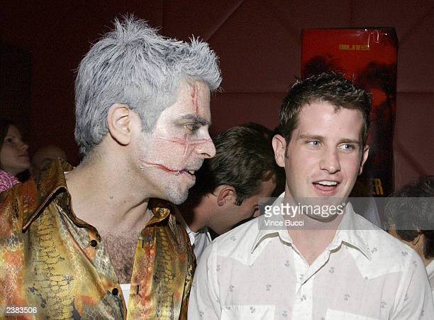 Directors Eli Roth wears make up while talking with director Richard Kelly at the afterparty for the premiere of the film Cabin Fever on August 8...