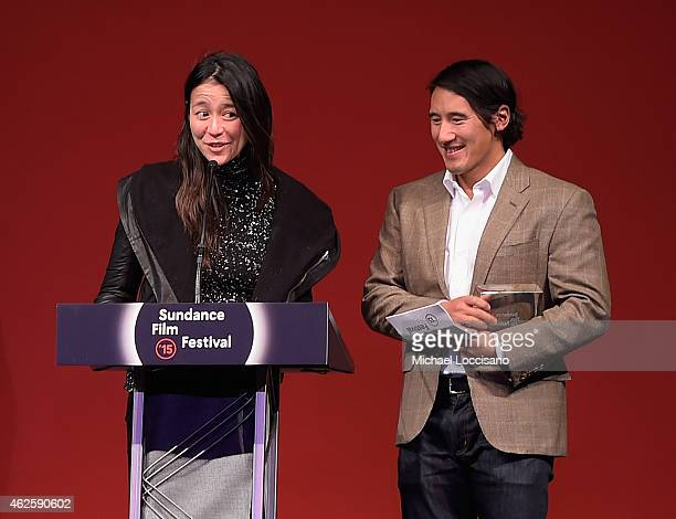 Directors Elizabeth Chai Vasarhelyi and Jimmy Chin of 'Meru' accept the U.S. Documentary Audience Award onstage at the Awards Night Ceremony during...