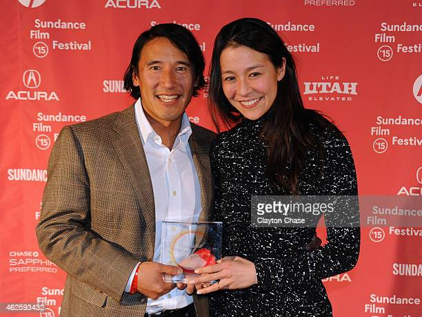 Directors Elizabeth Chai Vasarhelyi and Jimmy Chin of 'Meru' pose with the U.S. Documentary Audience Award onstage at the Awards Night Ceremony...