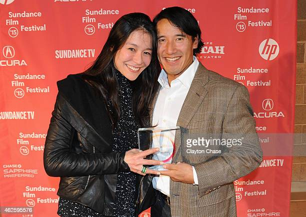 Directors Elizabeth Chai Vasarhelyi and Jimmy Chin of 'Meru' pose with the U.S. Documentary Audience Award at the Awards Night Ceremony during the...