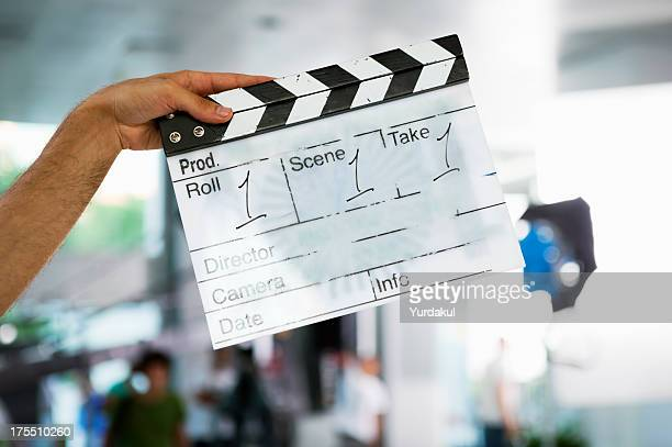 director's film slate showing roll 1, scene 1 and take 1 - clapboard stock pictures, royalty-free photos & images