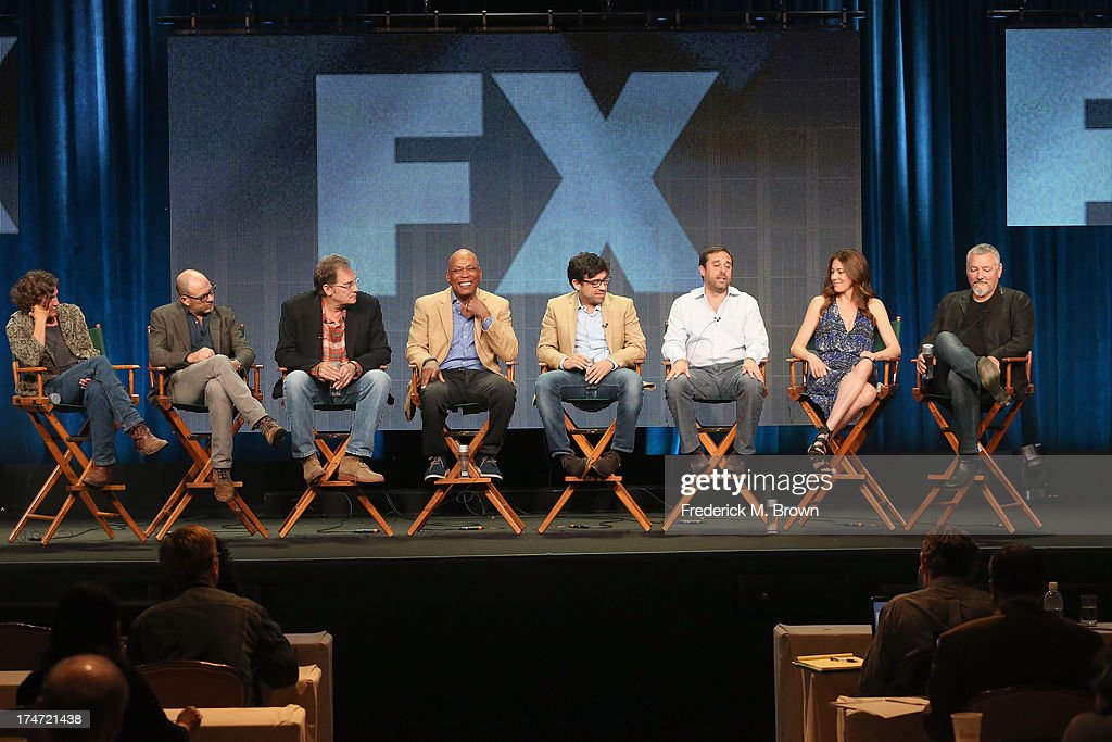 Directors Gwyneth Horder-Payton, Daniel Sackheim, Michael Dinner, Director and President of the Directors Guild of America Paris Barclay, Alfonso Gomez-Rejon, Jeff Schaffer, Jackie Schaffer and Randall Einhorn speak onstage during 'FX Directors' panel as part of the 2013 Summer Television Critics Association tour at the Beverly Hilton Hotel on July 28, 2013 in Beverly Hills, California.