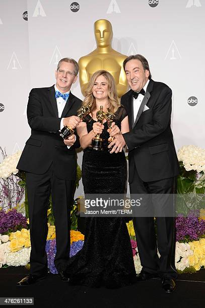 directors Jennifer Lee and Chris Buck and producer Peter Del Vecho winners of Best Animated Feature Film of the Year for 'Frozen' pose in the press...