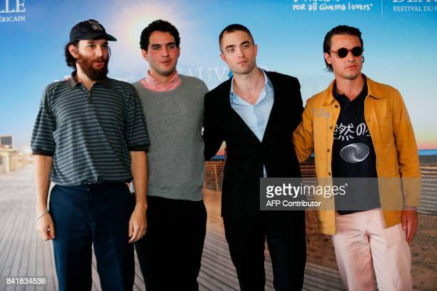 US directors Joshua and Ben Safdie British actor Robert Pattinson and US producer Oscar Boyson pose during a photocall for the film 'Good Time' at...