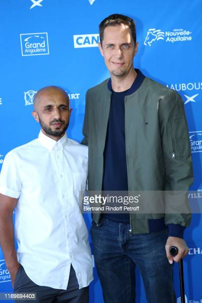 Directors Mehdi Idir and Grand Corps Malade aka Fabien Marsaud attend the Photocall of the movie La Vie Scolaire during the 12th Angouleme...