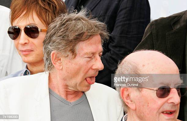 Directors Michael Cimino Roman Polanski and Manoel de Oliveira attend a photocall for the film Chacun Son Cinema at the Palais des Festivals during...