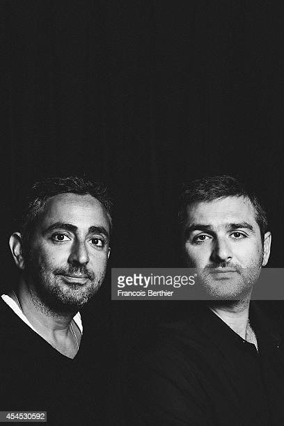Directors Olivier Nakache and Eric Toledano are photographed for Le Film Francais on August 29 2014 in Paris France