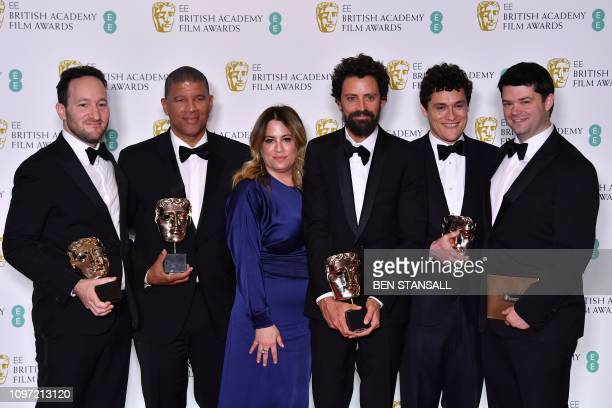 Directors Rodney Rothman and Peter Ramsey Christina Steinberg director Bob Persichetti screenwriter Phil Lord and Chris Miller pose with their awards...