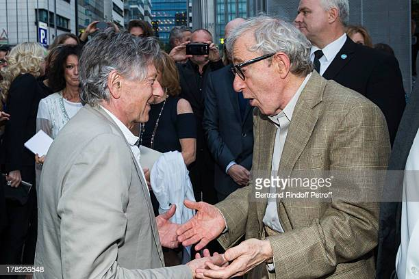 Directors Roman Polanski and Woody Allen arrive to the Paris premiere of 'Blue Jasmine' at UGC Cine Cite Bercy on August 27 2013 in Paris France
