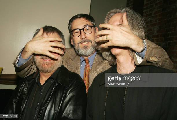 Directors Tobe Hooper John Landis and Mick Garris pose at a party to celebrate Showtime's series 'Masters of Horror' at Element on March 30 2005 in...