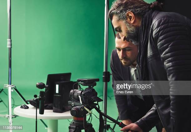 directors working on backstage in green box studio - film director stock pictures, royalty-free photos & images