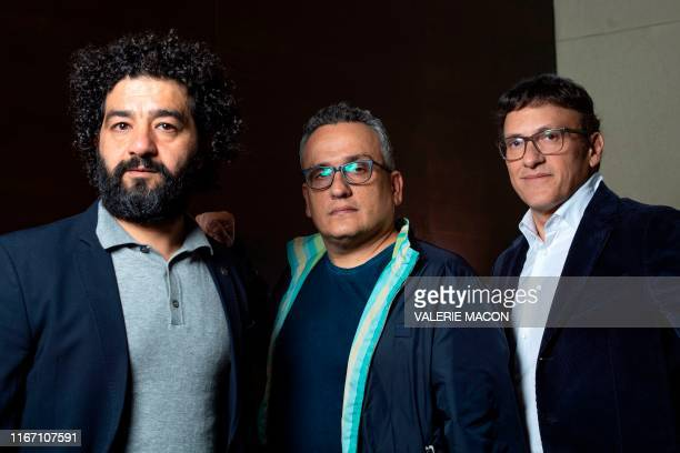 Directors/producers Mohamed AlDaradji Joseph Russo and Anthony Russo pose during a photo session for AFP at the 2019 Toronto International Film...