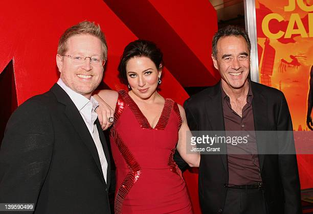 Director/writer Andrew Stanton actress Lynn Collins and producer Jim Morris arrive at the premiere of Walt Disney Pictures' 'John Carter' held at...