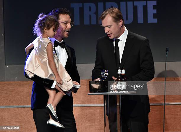 Director/writer Christopher Nolan presents the American Cinematheque Award to honoree Matthew McConaughey with Vida Alves McConaughey onstage at the...