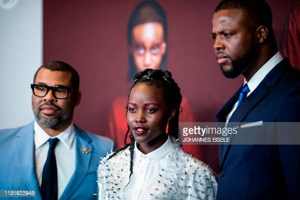 Director/writer Jordan Peele actress Lupita Nyong'o and actor Winston Duke arrive for the New York premiere of 'US' at the Museum of Modern Art on...
