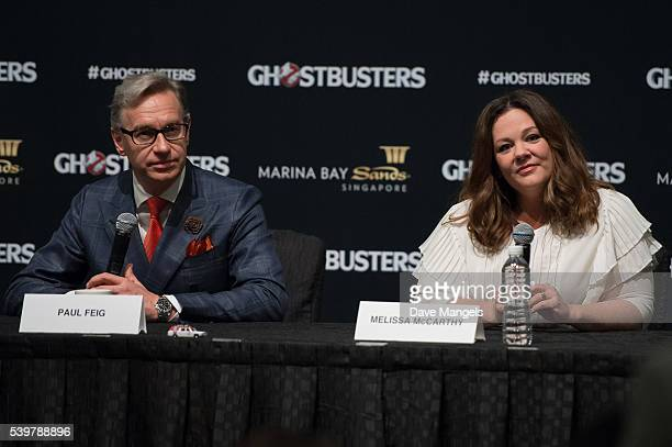 """Director/writer Paul Feig and actress Melissa McCarthy speak during the """"Ghostbusters"""" press conference held at the ArtScience Museum at Marina Bay..."""