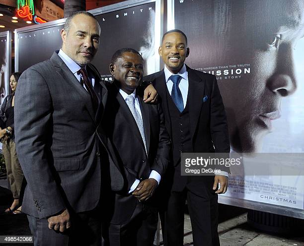 Director/writer Peter Landesman Dr Bennet Omalu and actor Will Smith arrive at the screening of Columbia Pictures' Concussion at Regency Village...