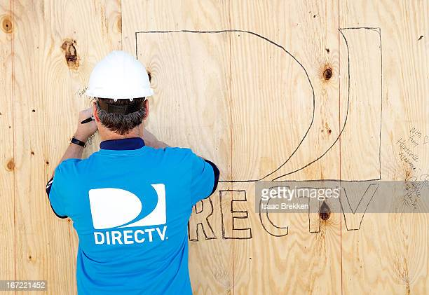 DirecTV CEO Mike White signs a wall as DirectTV volunteers build homes for Southern Nevada families with Habitat for Humanity on April 22 2013 in...