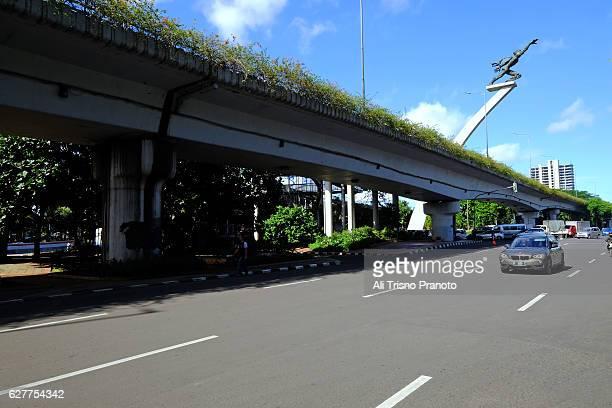 Dirgantara Stator Pancoran statue on clear morning. Jakarta city, Indonesia.