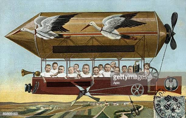 Dirigible carrying babies and pulled by storks birth postcard c 1905