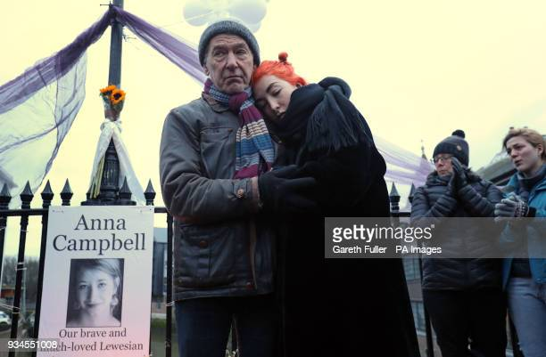 Dirk and Rose Campbell father and sister of Anna Campbell speak at a vigil in her home town of Lewes East Sussex as the British woman who died...